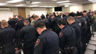Before parades roll, police have moment of silence