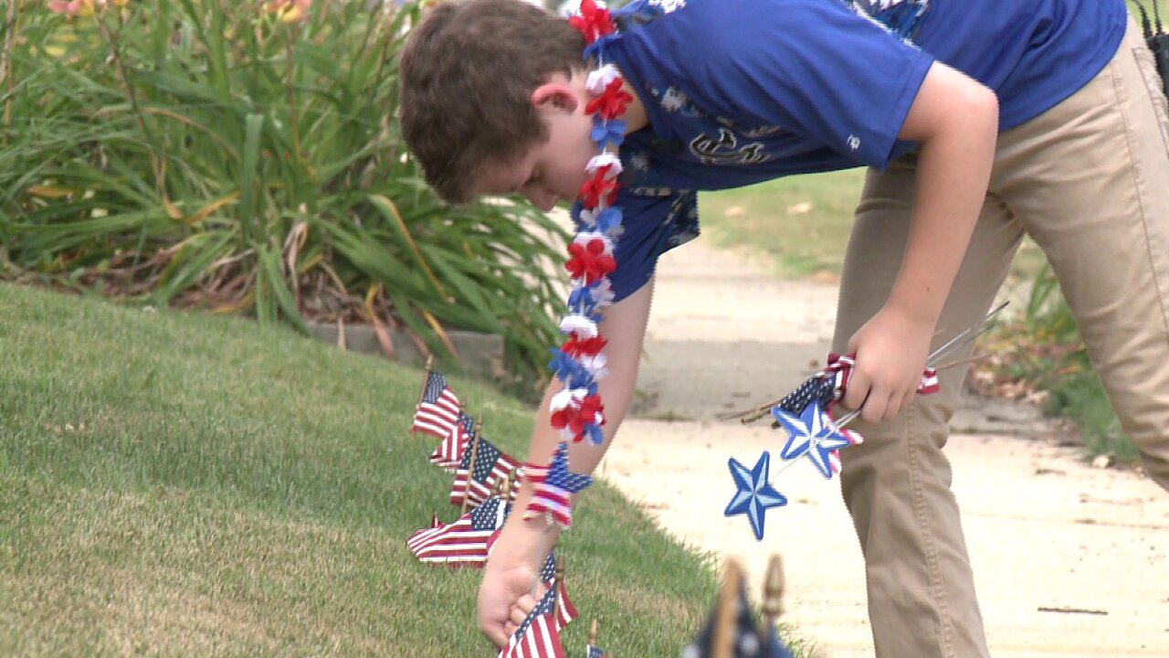 Virginia boy made it his mission to fill neighborhood with Americanflags