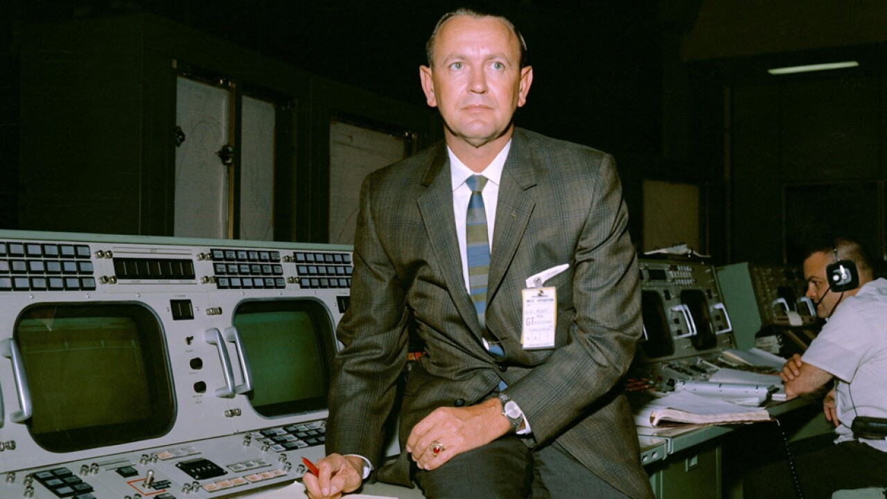 Chris Kraft is seen here at his flight director console in the Mission Control Center during Gemini-Titan V flight simulation.