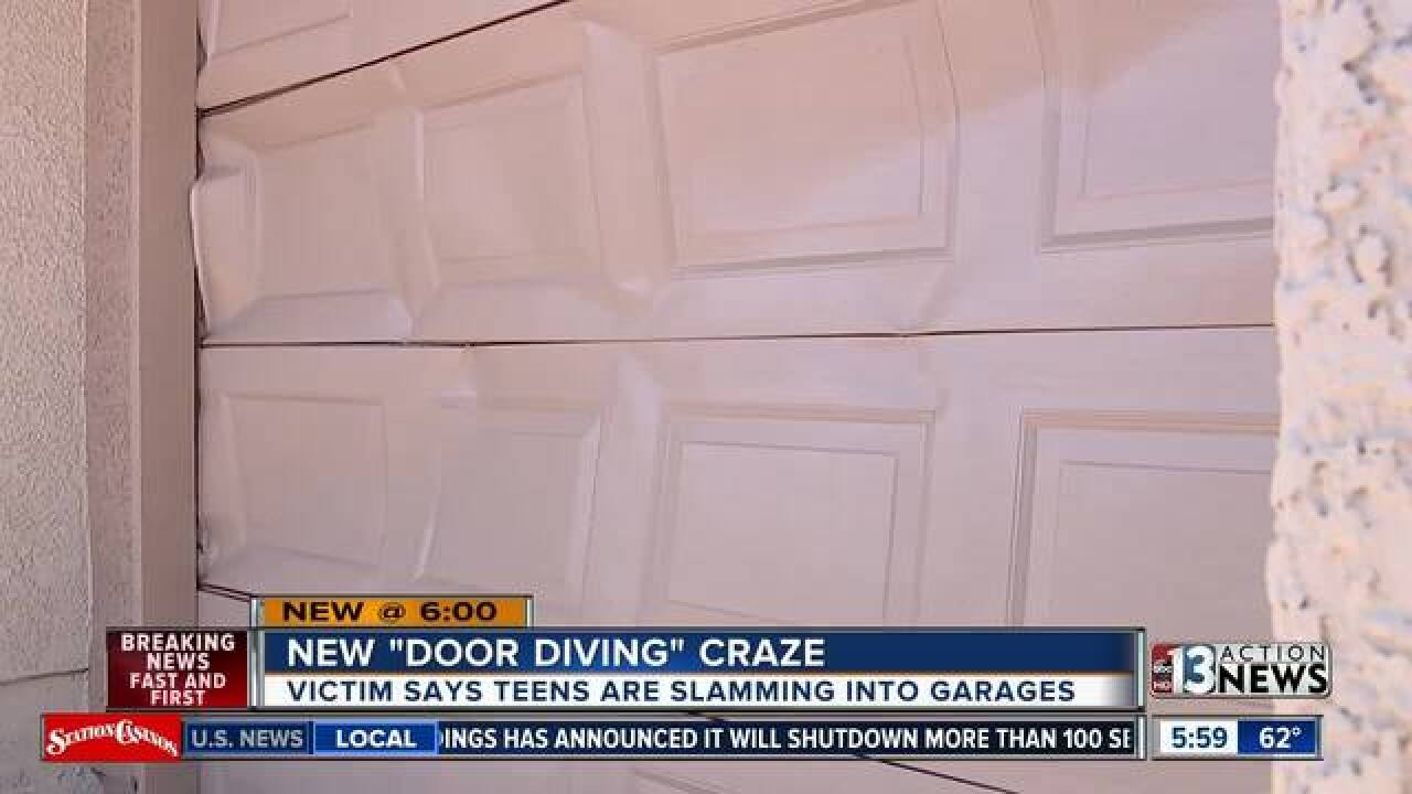 'Door Diving' trend leaves garage doors damaged