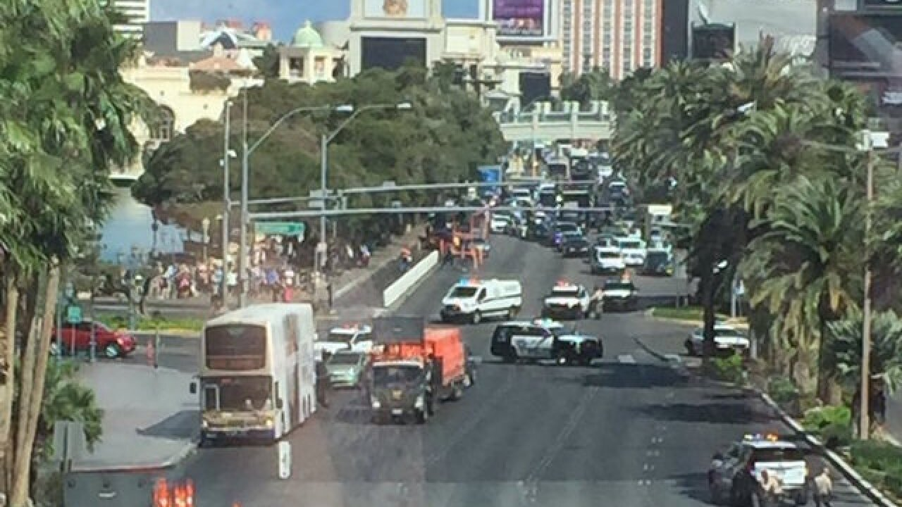 Las Vegas shooter in custody after killing 1 on strip, barricading self on bus