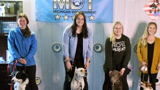 Therapy dogs graduate from training & read for work at Novi Public Schools