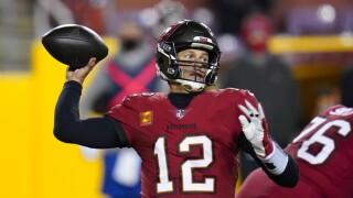 Tampa Bay Buccaneers QB Tom Brady throws vs. Washington in NFC wild-card playoff