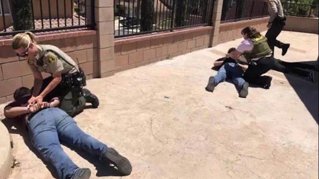 Man takes photo of burglars held at gunpoint