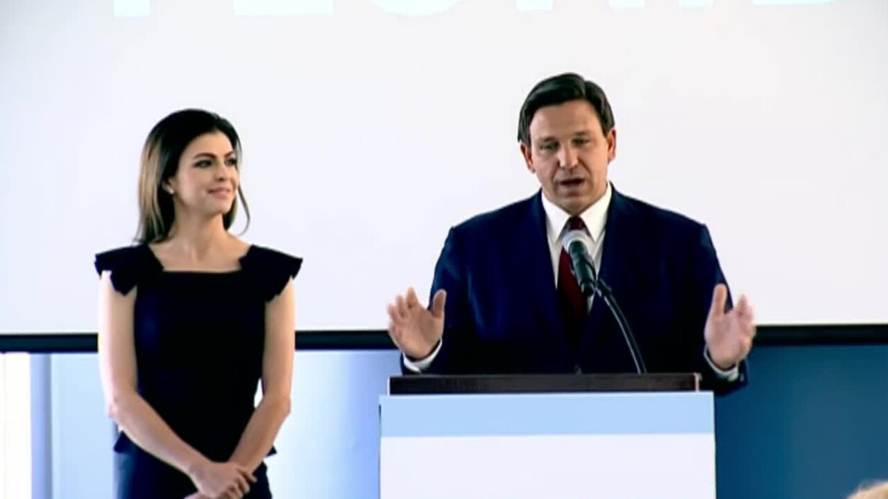 Florida Gov. Ron DeSantis and First Lady Casey DeSantis hold a news conference in Orlando on Feb. 26, 2021.jpg