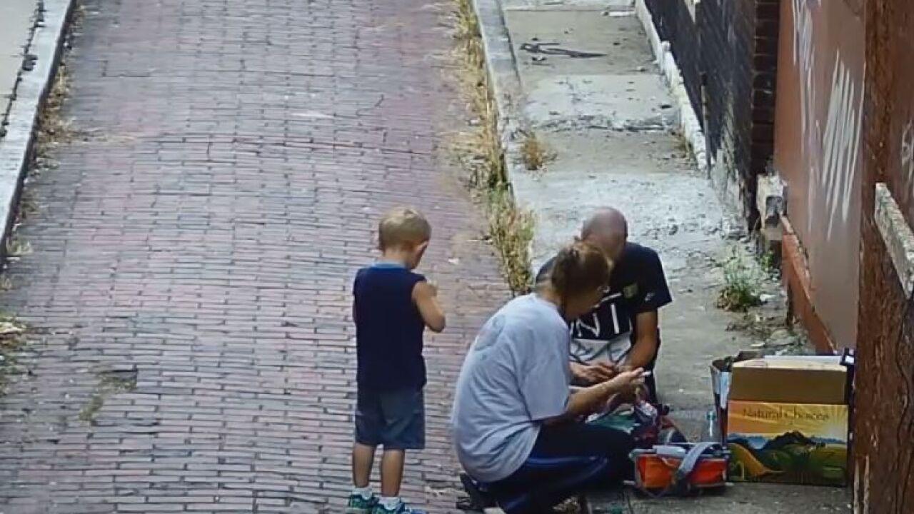 Video shows boy watch mother shoot heroin 1