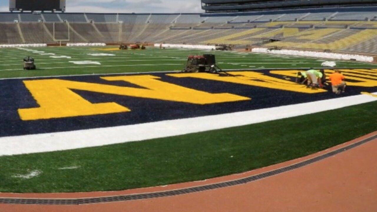 SEE IT: Time-lapse of Michigan Stadium's new field turf installation
