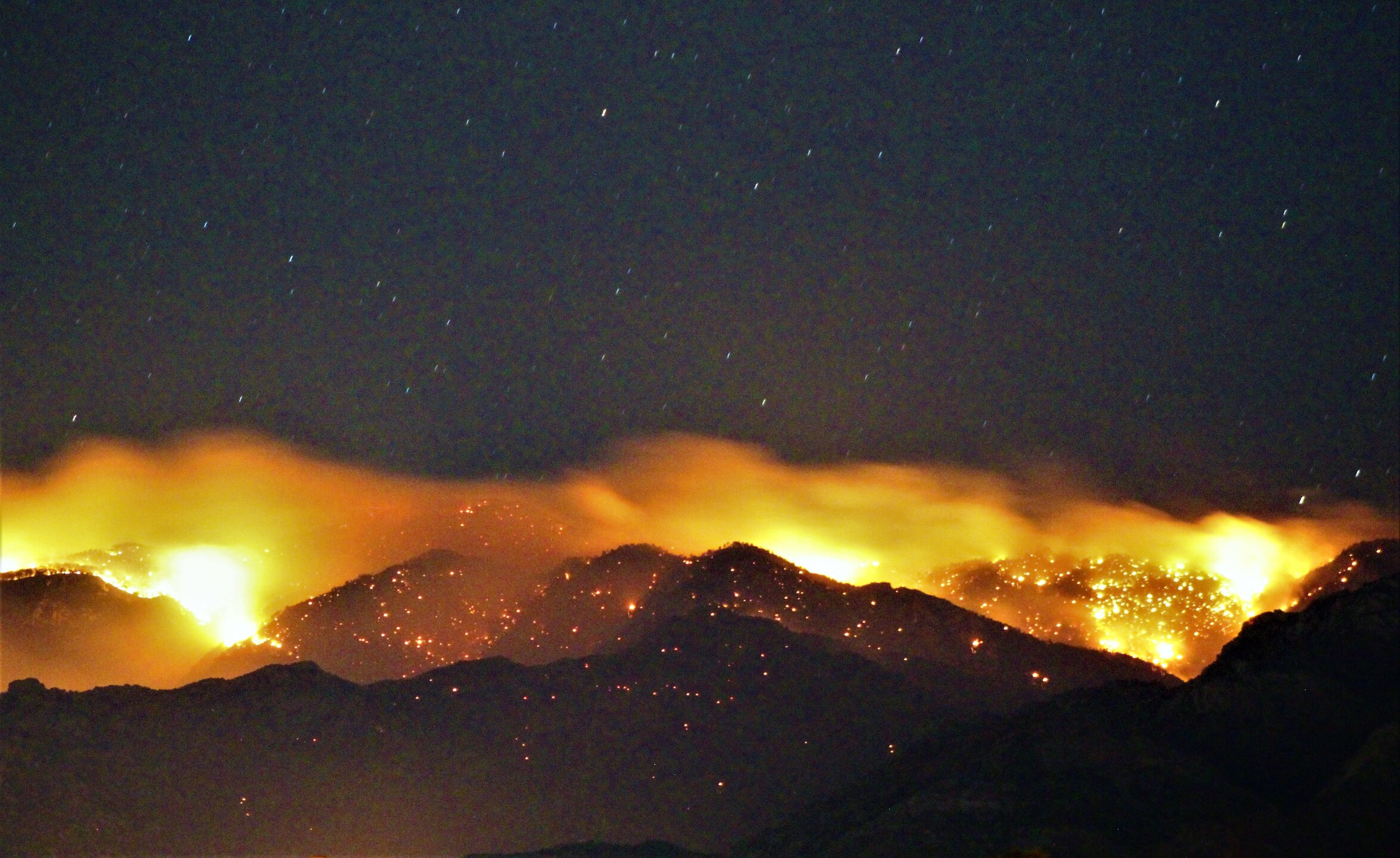 The Bighorn Fire burning in the Catalina Mountains creeps toward toward Mount Lemmon
