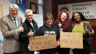 Members of Milwaukee's Street Angles after helping pass Code Blue Emergency