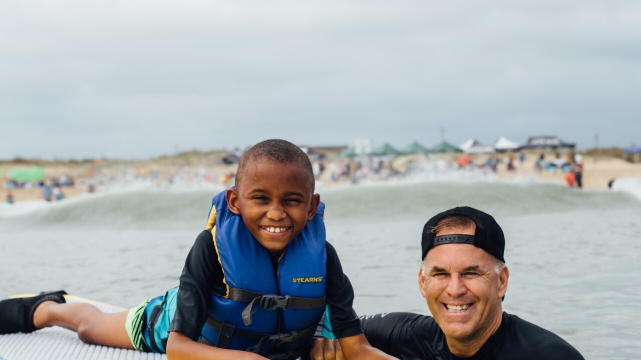 Surfers take children with special needs surfing in Sandbridge as form of therapy