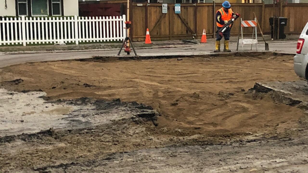 Crews work to repair road after water main break