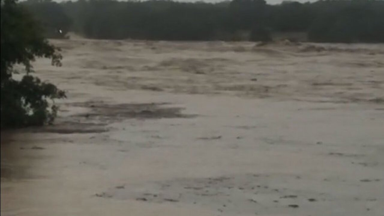 A flooded Texas river rose 35 feet in a day and crushed a bridge