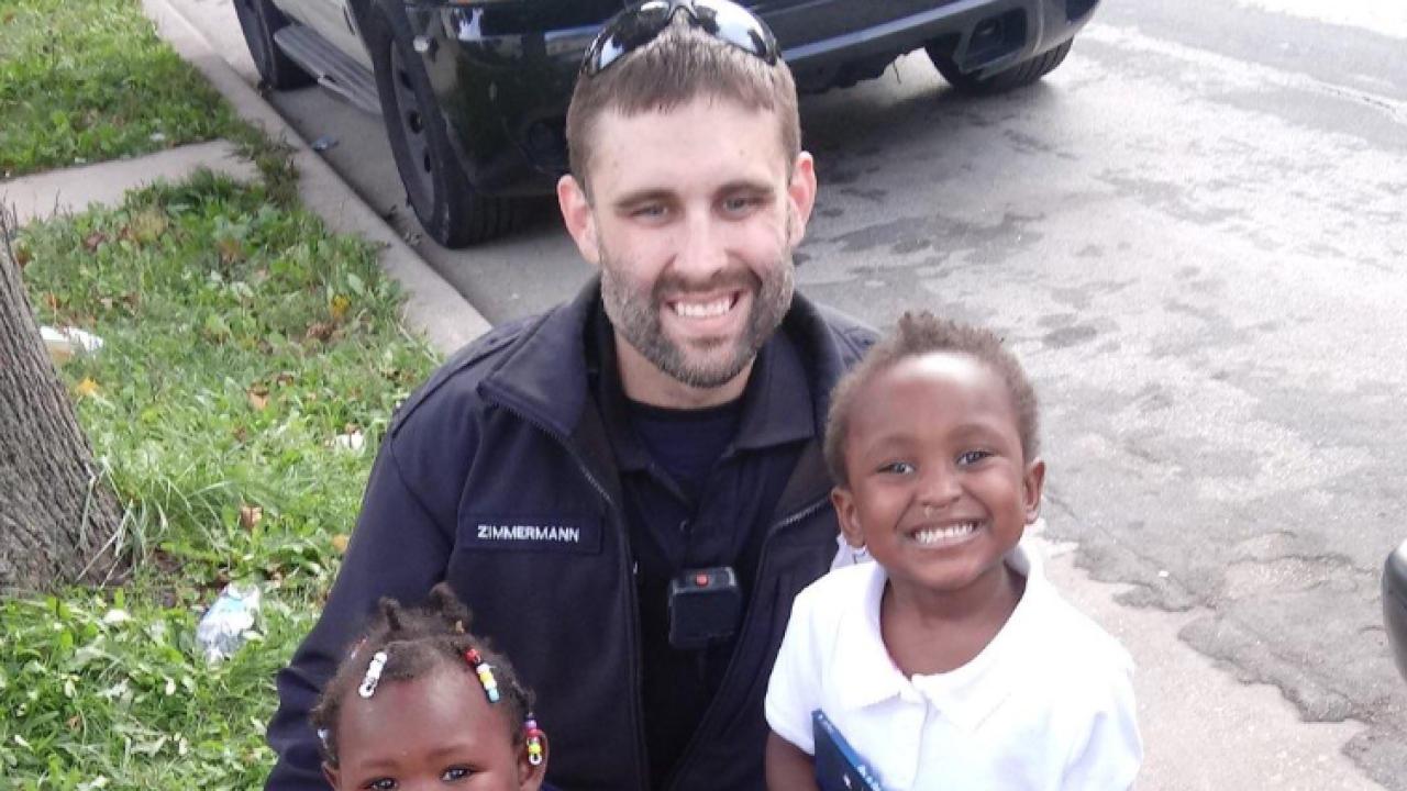 Officer Zimmerman with car seat children