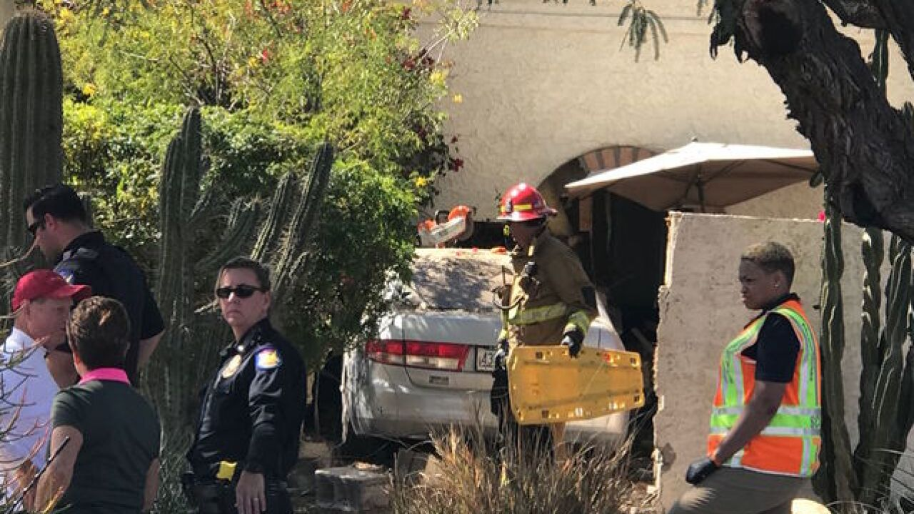 Phoenix FD: Elderly man and woman badly hurt after crashing into house