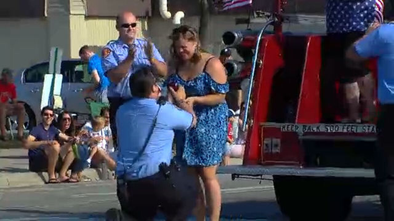VIDEO: Local firefighter proposes during parade