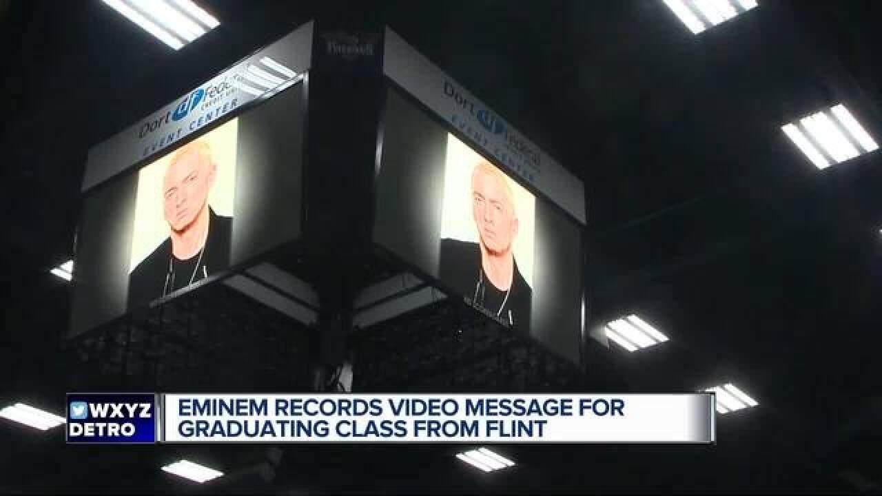Eminem suprises class in Flint at graduation
