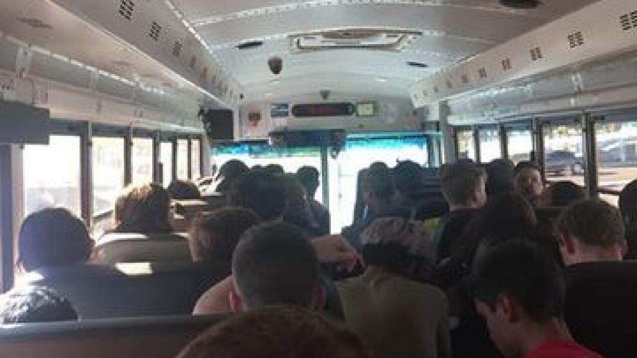 Photos show children on floor of CCSD school bus