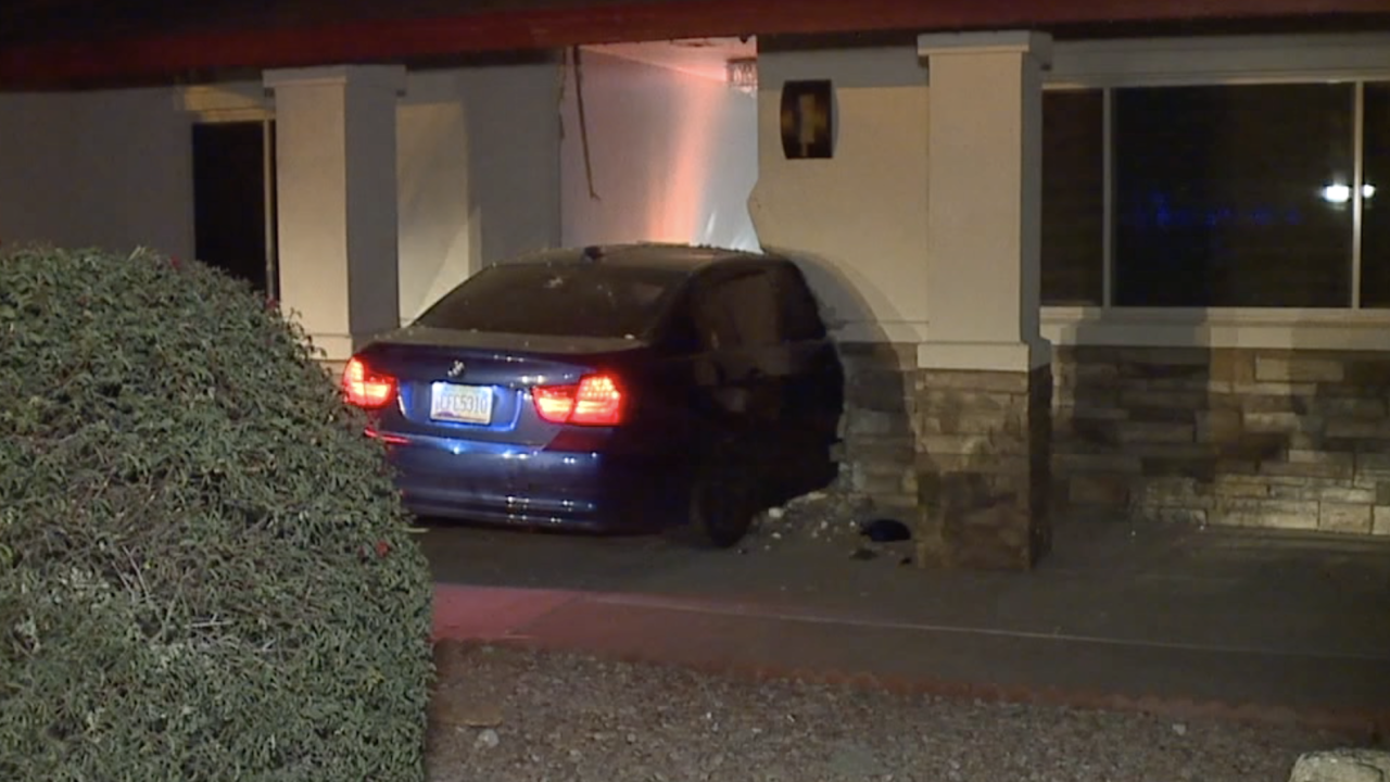 Car into house near 35th and Peoria avenues
