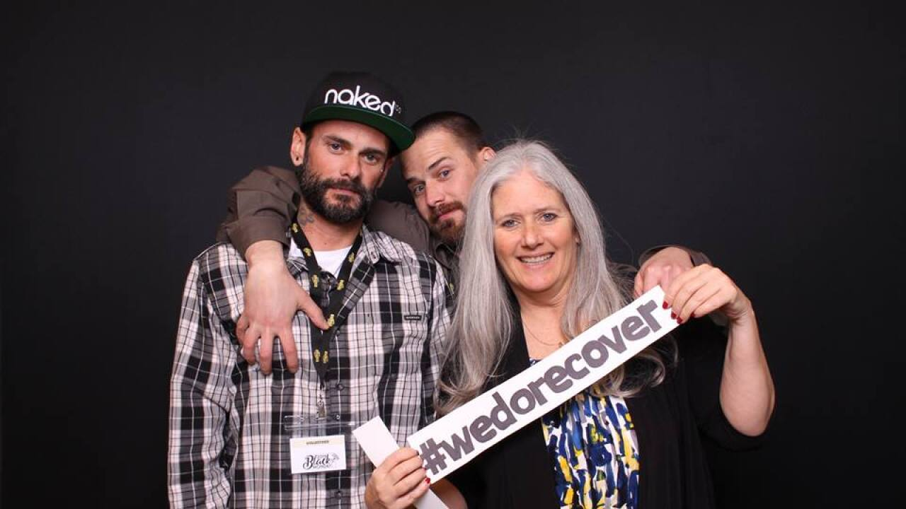 Rhonda Fairchild with her two sons, who have been in recovery for more than a year