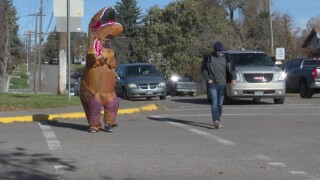 """T-rex"" helps kids cross the road safely in Great Falls"