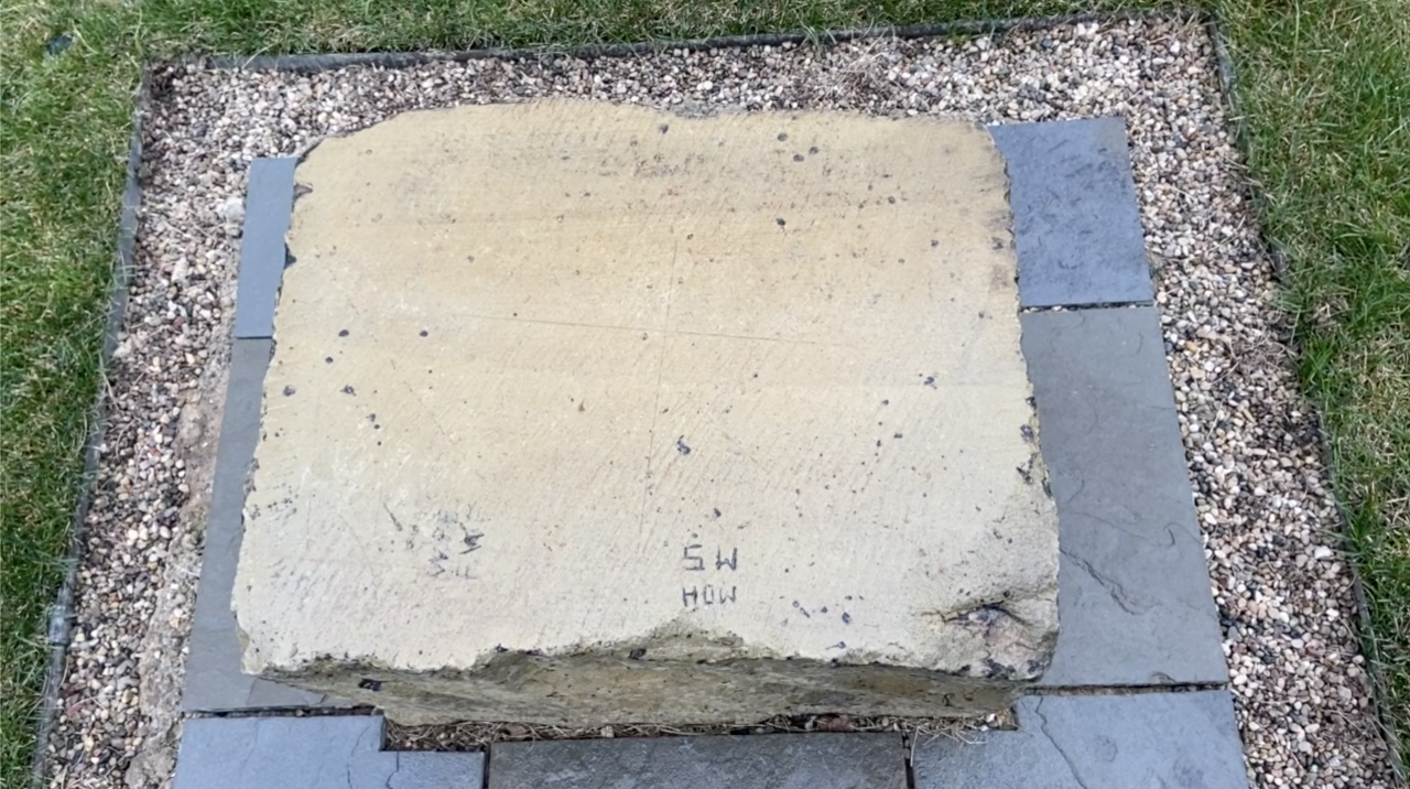 One of the stones carved with perpendicular meridian lines that allowed early surveyors to use astronomy to map the area