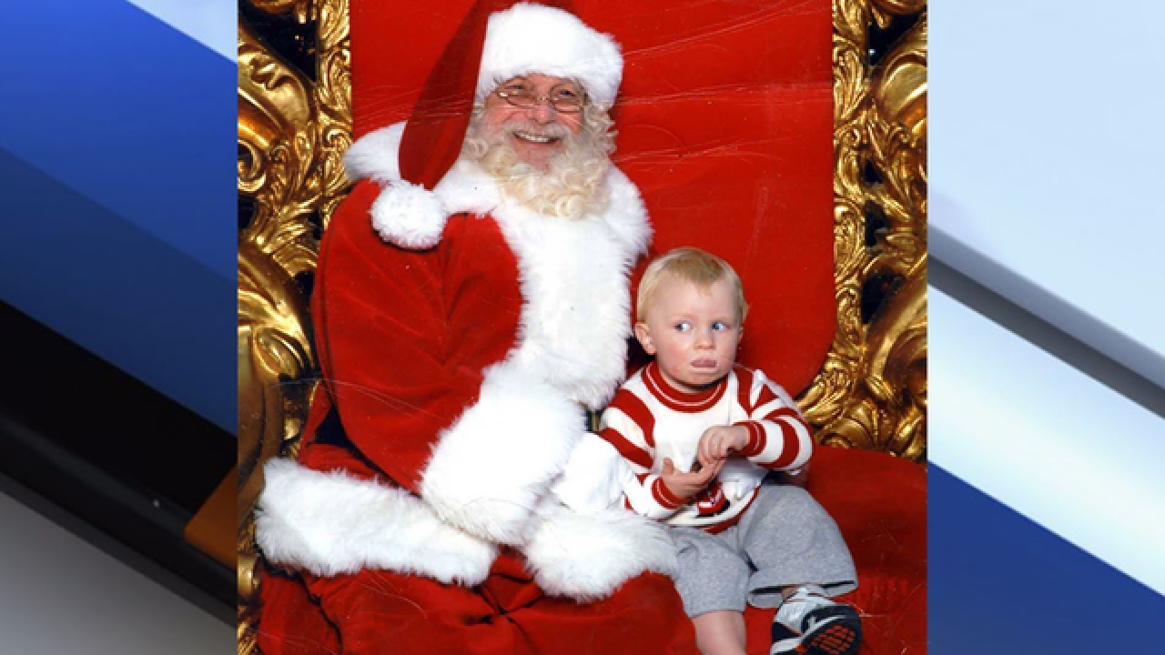 Boy signals 'help' in sign language after being placed on Santa's lap