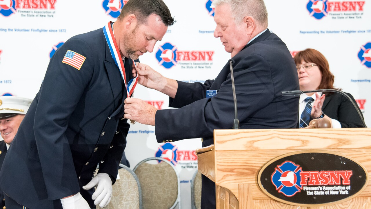 FASNY_2019_EMSProvideroftheYear_Christopher_Tracey-Honored-by-FASNY-President-Steven-Klein-at-147th-Annual-FASNY-Convention-LiverpoolNY-8_11_19-Credit - Mitch Wojnarowicz for FASNY.jpg