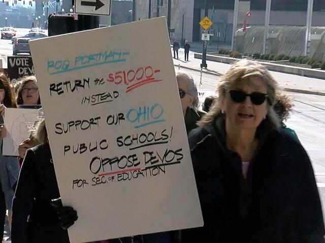 PHOTOS: Dozens protest DeVos near Sen. Portman's office