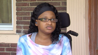Justine Jones speaks with WCPO while sitting in the wheelchair she uses for mobility due to spina bifida.