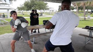 Jacusto Colon (right) boxing with trainee Mason Moreno (left).