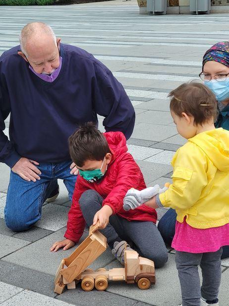 Art Vogt giving truck to kids.JPG
