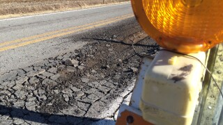 Whitmer works on new roads plan, warns of budget pressures
