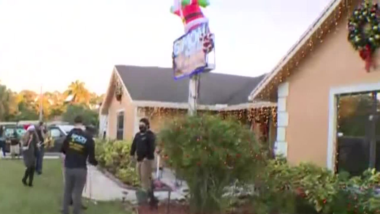 Volunteers decorate Forbes family home