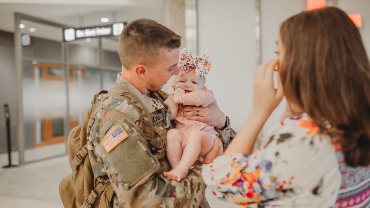 PHOTOS | Florida soldier returns from deployment, meets baby girl for first time