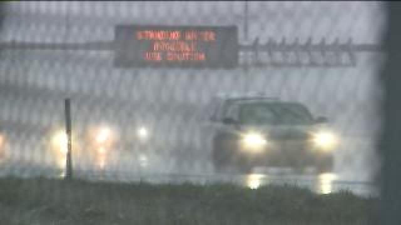 Road conditions hampered by rain,snow
