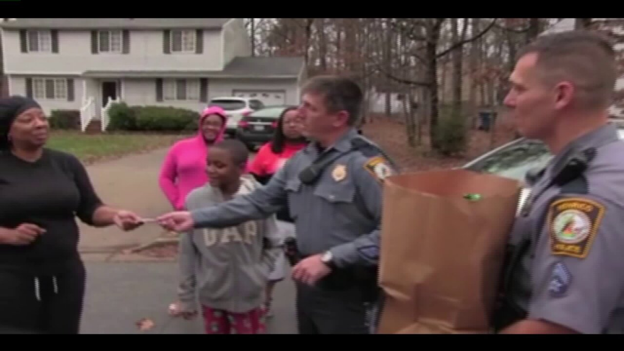 Henrico Police shower adopted family with gifts and food forChristmas