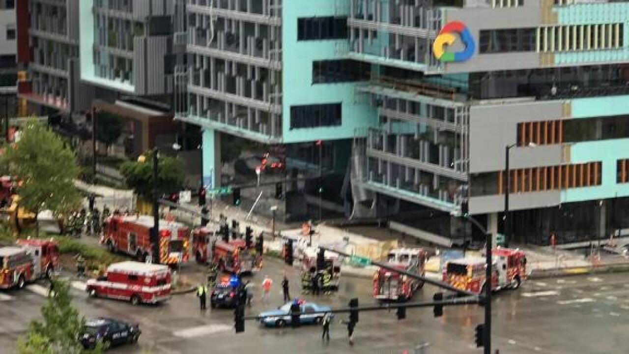 Construction crane falls on vehicles in Seattle, killing two workers and two people in cars
