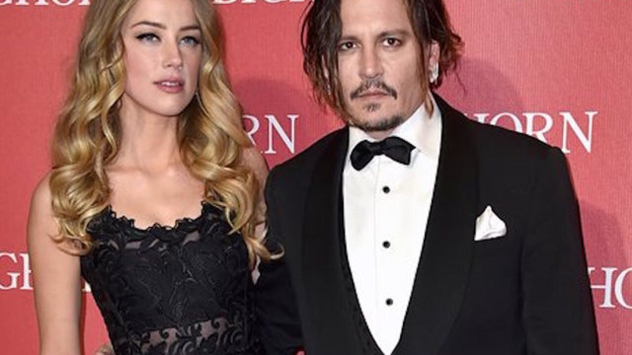Amber Heard withdraws abuse accusation against Johnny Depp
