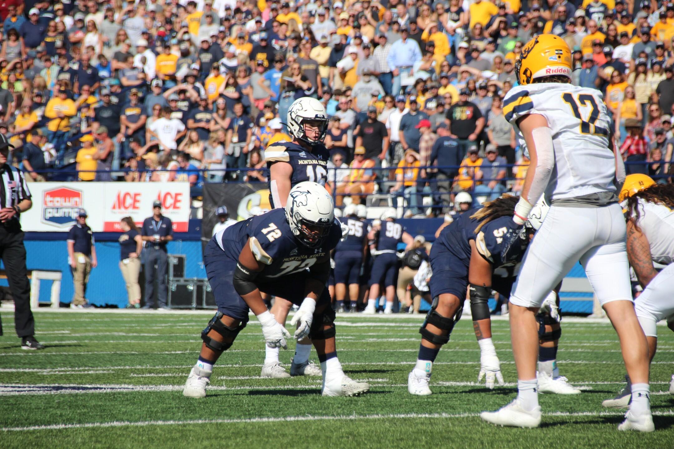 Tommy Mellot takes a snap at quarterback