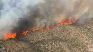 Authorities made progress toward containing one of two major wildfires in south-central Arizona's desert hill country, allowing evacuation notices to be lifted for several rural areas though towns elsewhere continued to be threatened. Photo via ABC15.