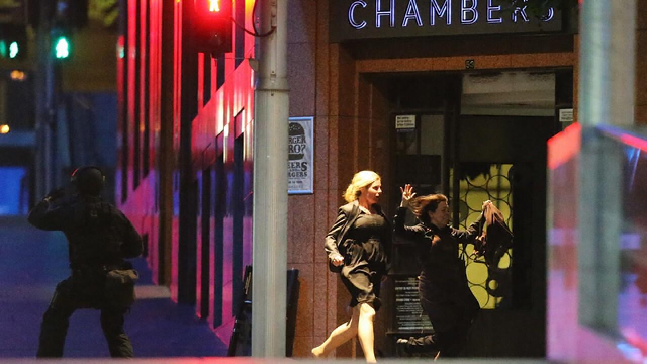 PICS: Standoff at Sydney cafe