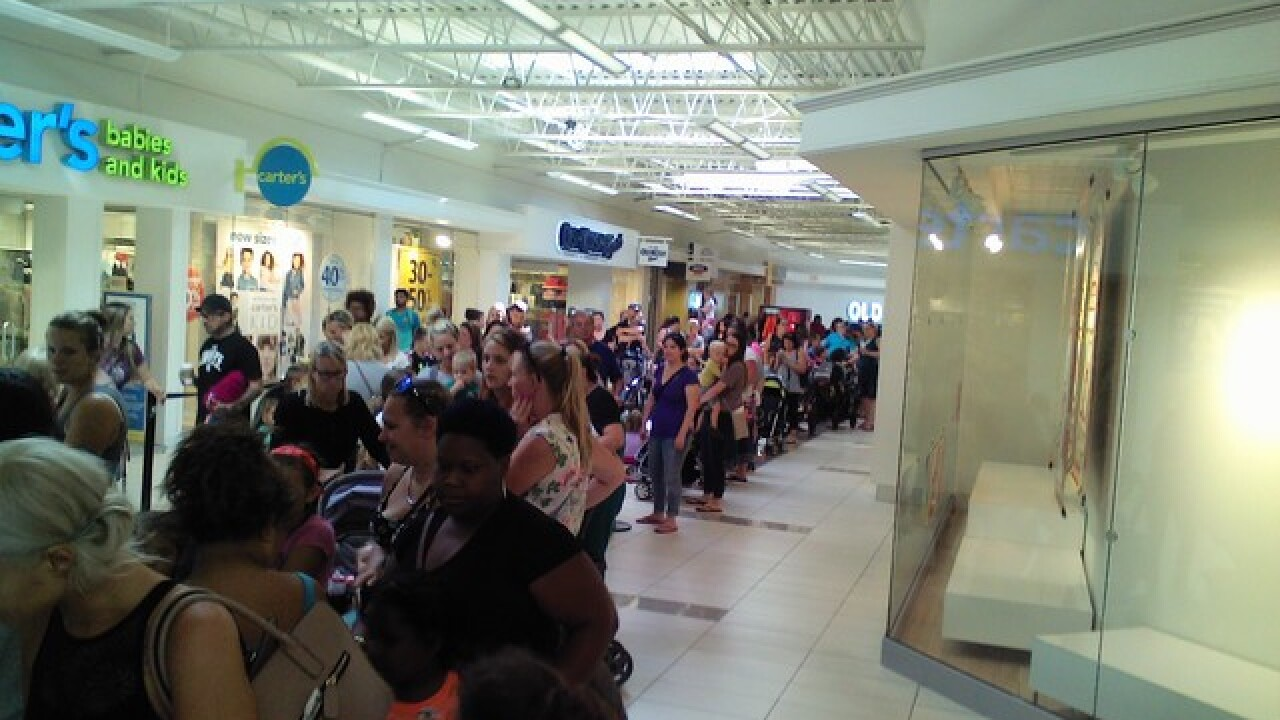 Long lines for Pay Your Age Day at Build-A-Bear