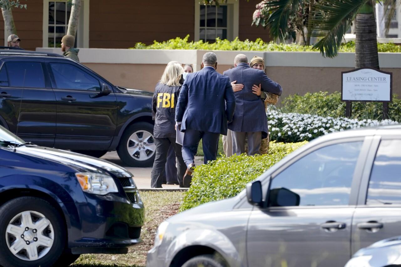 Law enforcement embrace outside scene of FBI shooting in Sunrise