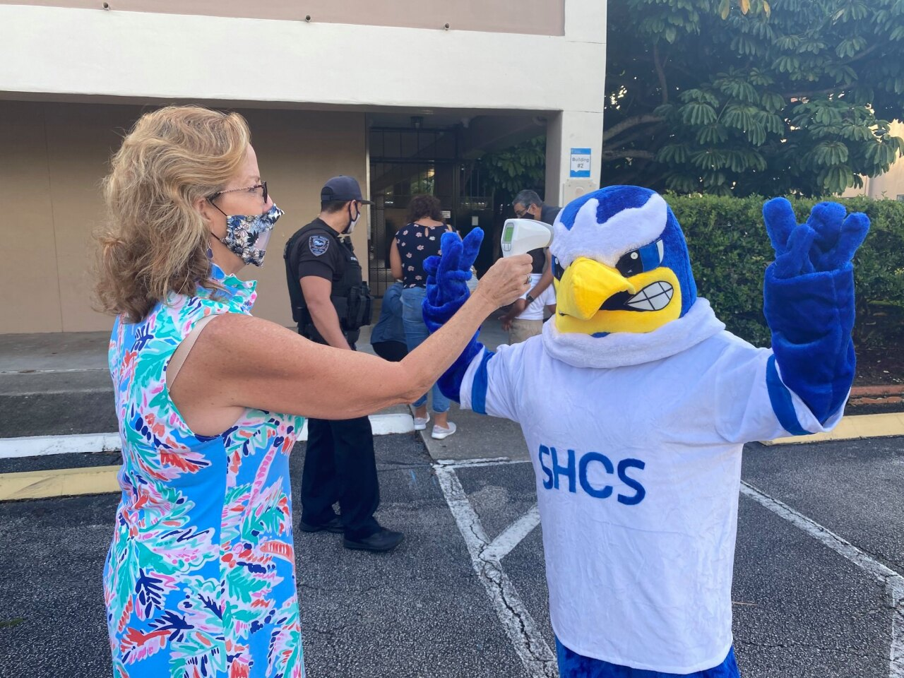 St. Helen Catholic School teacher conducts temperature check of Eagle mascot