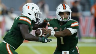 Miami Hurricanes QB D'Eriq King hands off to running back Donald Chaney vs. Appalachian State Mountaineers in 2021