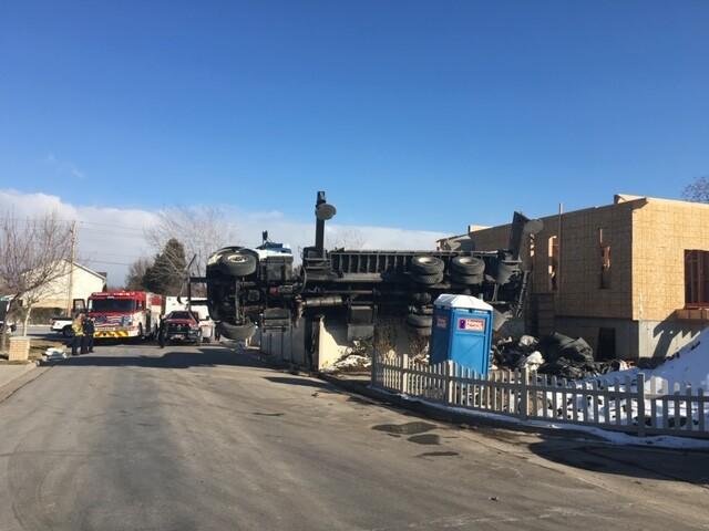 Photos: Crane comes crashing down onto South Jordanhome