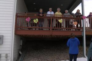 While on lockdown, Helena assisted living facility unites families through balcony visits