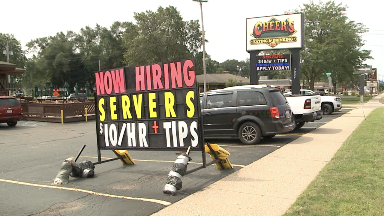 Now hiring sign outside Cheers.png