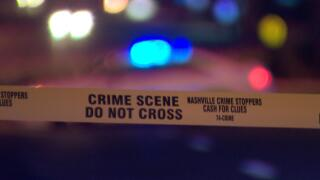 crime scene tape metro police car blurry.jpg