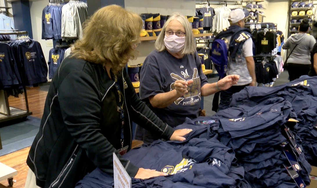 Jayne Miles picking out Brewers gear
